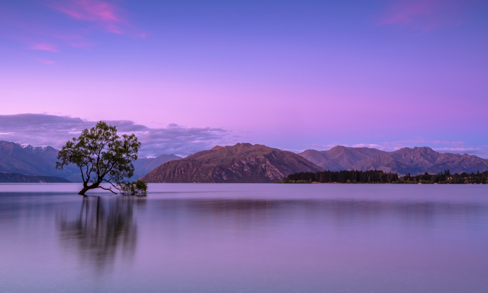 Peaceful lake with mountains and trees